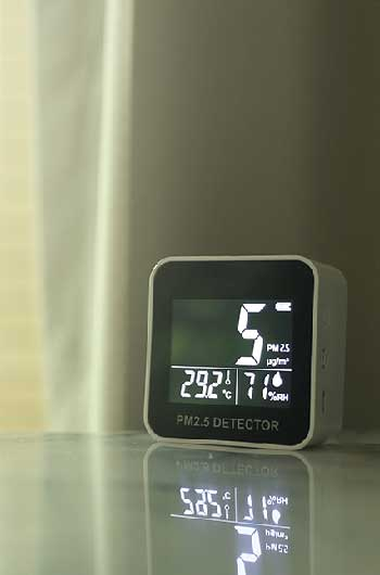 digital alarm clock with air thermometer