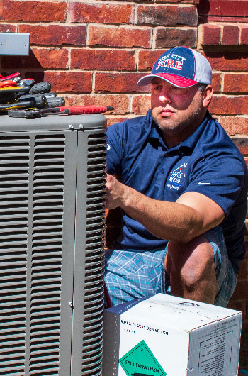 Above & Beyond Service tech with working on AC unit