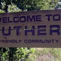 sign that says welcome to Luther a friendly community
